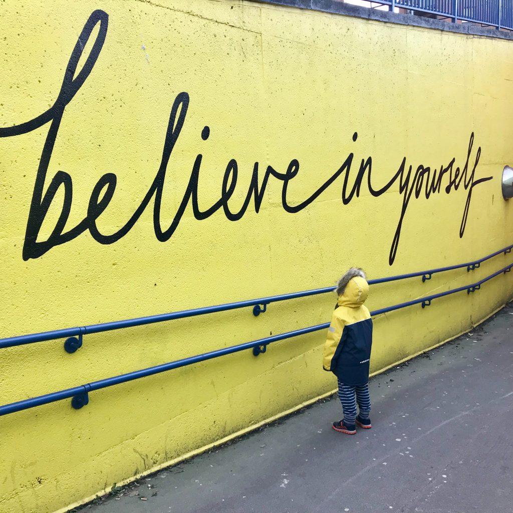 believe in yourself written on a wall