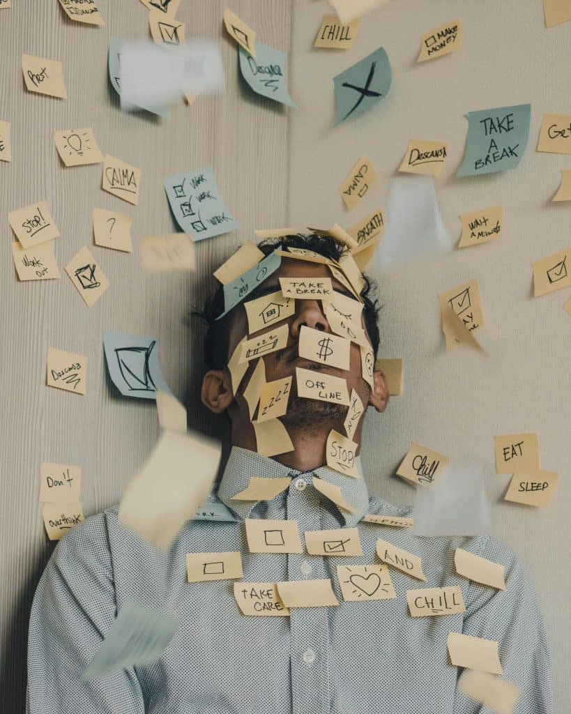 man surrounded and covered with stick notes