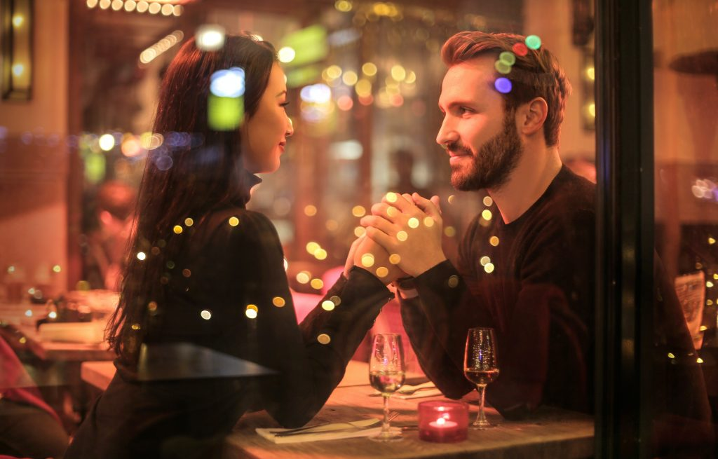 people relaxing on a romantic restaurant date