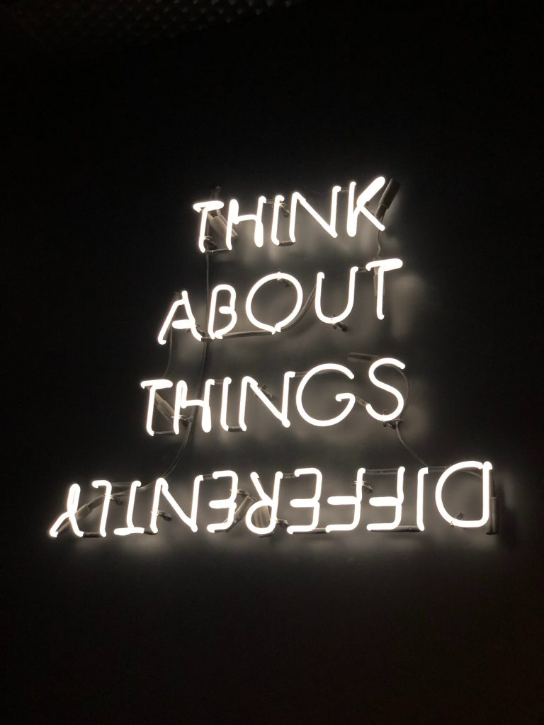 lights saying think about things differently