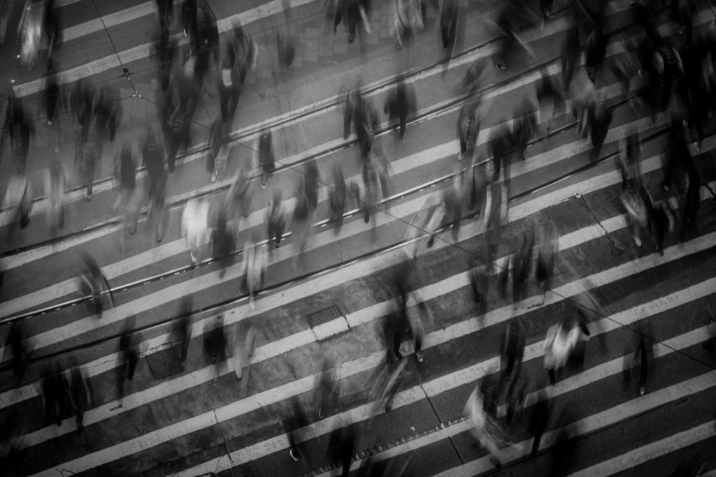 black and white photo of people rushing about