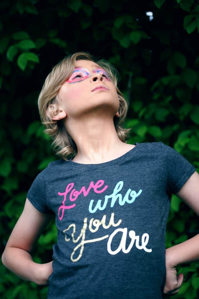 girl wearing 'love who you are' t-shirt
