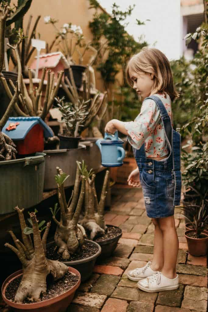 girl watering her garden
